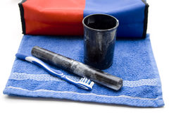 Cosmetics bag with toothbrush and oral mug Stock Images