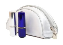 Cosmetics bag and two lipstick Royalty Free Stock Photo