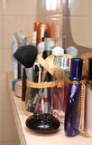 Cosmetics in the bathroom. Cosmetics are standing on the shelf in the bathroom Royalty Free Stock Photo