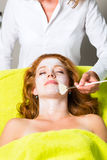 Cosmetics and Beauty - applying facial mask Stock Photos