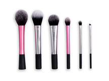 Cosmetics, beauty, make-up brushes set in row. Makeup brushes set in row on white isolated background. Cosmetics and beauty Royalty Free Stock Images