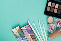 Cosmetics on blue workplace Stock Photo