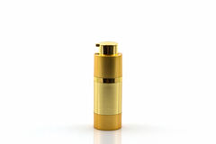 Cosmetics bottle, Golden Blank packaging bottle. Stock Photo