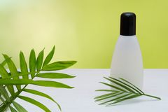 Cosmetics bottle product mock up without branding. Cosmetics bottle mock up with blank label to add branding to product on light fresh background stock photos