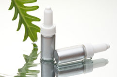 Cosmetics bottle on water Stock Photo