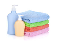 Cosmetics bottles and towels Stock Photos