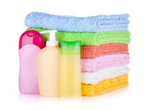 Cosmetics bottles and towels Stock Photography