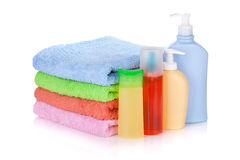Cosmetics bottles and towels Royalty Free Stock Photography