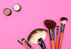Cosmetics and brushes. For a make-up on a pink background Royalty Free Stock Image