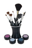 Cosmetics with brushes in stand Royalty Free Stock Photography