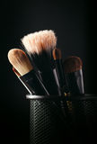 Cosmetics brushes in a wire container Stock Photo