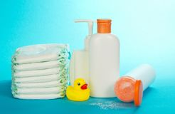 Cosmetics on care of the child and diapers Stock Photos