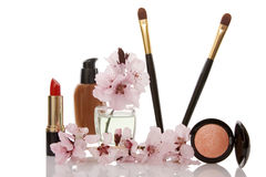 Cosmetics and cherry flower Royalty Free Stock Images