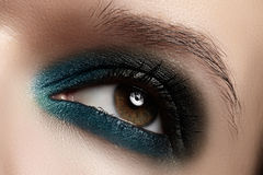 Cosmetics, close-up eye make-up. Fashion eyeshadow Stock Photography