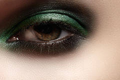 Cosmetics, close-up eye make-up. Fashion glitter green mint eyeshadow Stock Photography