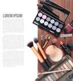 Cosmetics. Closeup makeup brush cosmetics on wooden plank background stock photo