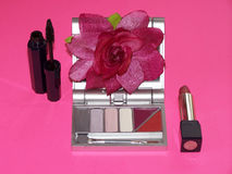 Cosmetics Collection With Pink Flower. Cosmetics with Rose on Bright Pink Background Royalty Free Stock Image