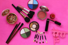 Cosmetics. The composition of eye shadow, brushes, powder, blush, mascara. Royalty Free Stock Photo