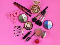 Cosmetics. The composition of eye shadow, brushes, powder, blush, mascara. Stock Photo