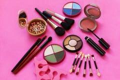 Cosmetics. The composition of eye shadow, brushes, powder, blush, mascara. Royalty Free Stock Photos