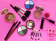 Cosmetics. The composition of eye shadow, brushes, powder, blush, mascara Royalty Free Stock Images