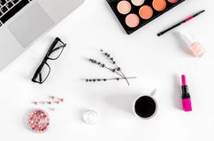 Cosmetics composition with glasses and laptop top view Stock Images