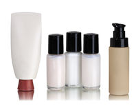 Cosmetics containers. Different Cosmetics containers on a mirror with white background Stock Images