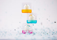 Cosmetics containers playfully stacked on top of each other. Small cosmetics containers playfully stacked on top of each other Royalty Free Stock Image