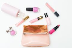 Cosmetics and cosmetic bag of pink color on a white background. Royalty Free Stock Photos