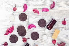 Cosmetics cream lotions cookies. On a white wooden background Royalty Free Stock Image