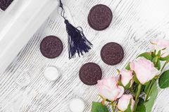 Cosmetics cream lotions cookies. On a white wooden background Royalty Free Stock Photography