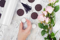Cosmetics cream lotions cookies. On a white wooden background Stock Photography