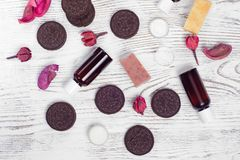 Cosmetics cream lotions cookies. On a white wooden background Royalty Free Stock Photos