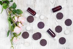 Cosmetics cream lotions cookies. On a white wooden background Stock Image