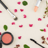 Cosmetics decorated with pink crape myrtle petals. Leaves and budding flowers on muslin fabric stock images