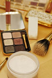 Cosmetics details. Colorful cosmetics details with brush Stock Images