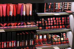 Cosmetics display in store. Cosmetics display in a store showing all various colors Royalty Free Stock Image