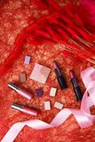 Cosmetics (eye shadow, lipsticks, powder) Stock Photos