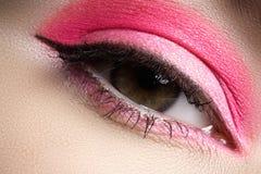Cosmetics, eyeshadows. Macro fashion eye make-up. Cosmetics and beauty care. Macro close-up of beautiful green female eye with bright fashion make-up. Rainbow stock photography