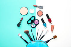 Cosmetics and fashion background with make up artist objects: lipstick, eye shadows, mascara ,eyeliner, concealer, nail polish. b. Lue and white background royalty free stock photos
