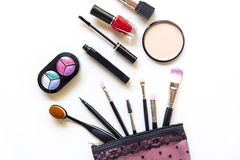 Cosmetics and fashion background with make up artist objects: lipstick, eye shadows, mascara ,eyeliner, concealer, nail polish. Royalty Free Stock Photography