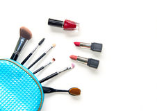 Cosmetics and fashion background with make up artist objects: lipstick, eye shadows, mascara ,eyeliner, concealer, nail polish. Royalty Free Stock Image