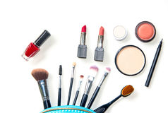 Cosmetics and fashion background with make up artist objects: lipstick, eye shadows, mascara ,eyeliner, concealer, nail polish. Lifestyle Concept stock images