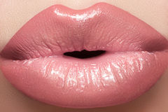 Cosmetics, gloss make-up. Macro fashion lips kiss Stock Photo