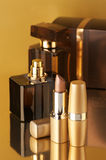 Cosmetics on gold Stock Photo