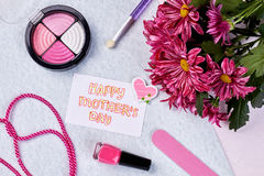 Cosmetics, greeting card and flowers. Stock Image