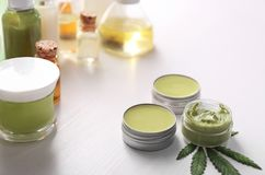 Cosmetics with hemp extract. On white table stock images