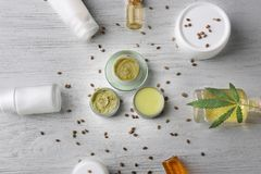 Cosmetics with hemp extract on wooden background royalty free stock photography