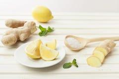 Cosmetics homemade lemon, ginger, salt and essential oils on wh. Cosmetics homemade lemon, ginger, salt and essential oils royalty free stock image