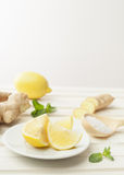 Cosmetics homemade lemon, ginger, salt and essential oils on wh. Cosmetics homemade lemon, ginger, salt and essential oils royalty free stock photo